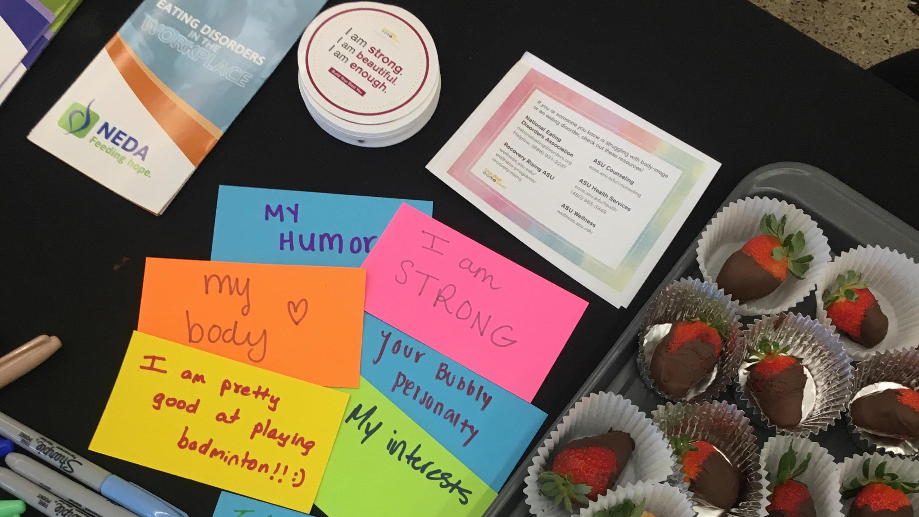 """Affirming messages written on post-it notes such as """"i am enough"""" for an ASU event about eating disorder awareness"""